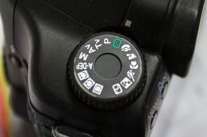 Généralement le mode automatique est représenté par un petit rectangle vert sur votre sélecteur de modes photo.